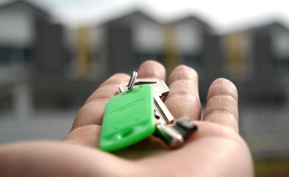 open hand holding house keys