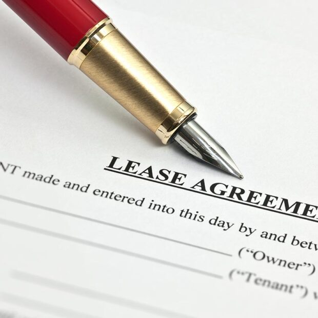 Lease agreement document and pen